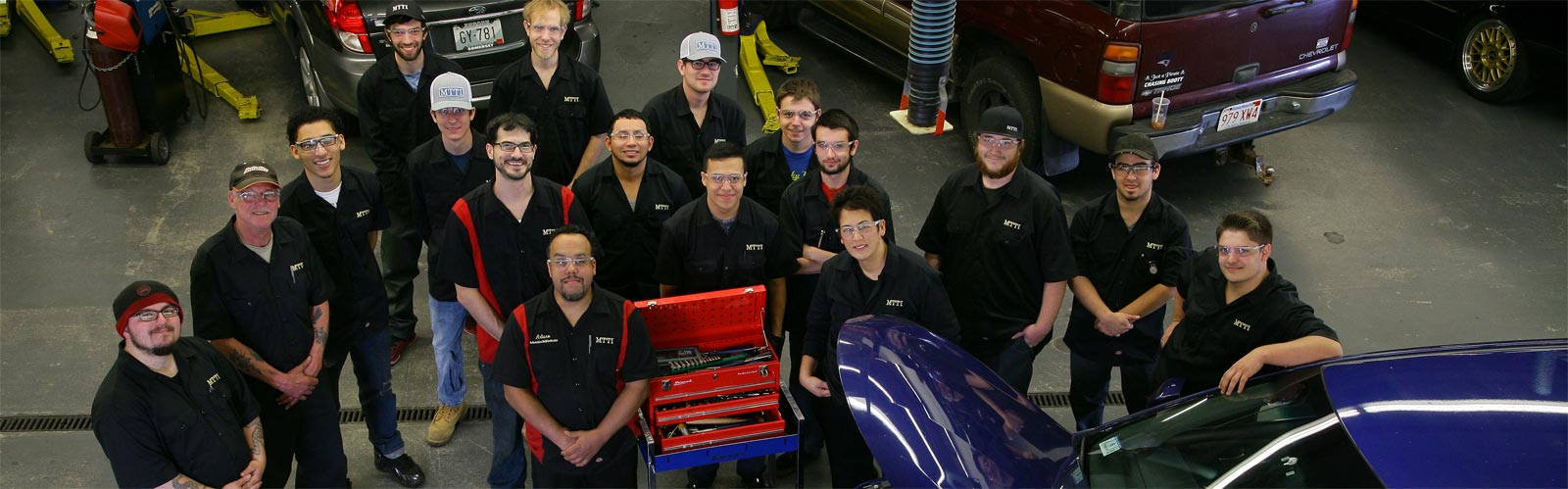 Class photo of 2016 Auto Mechanic students in the shop at MTTI