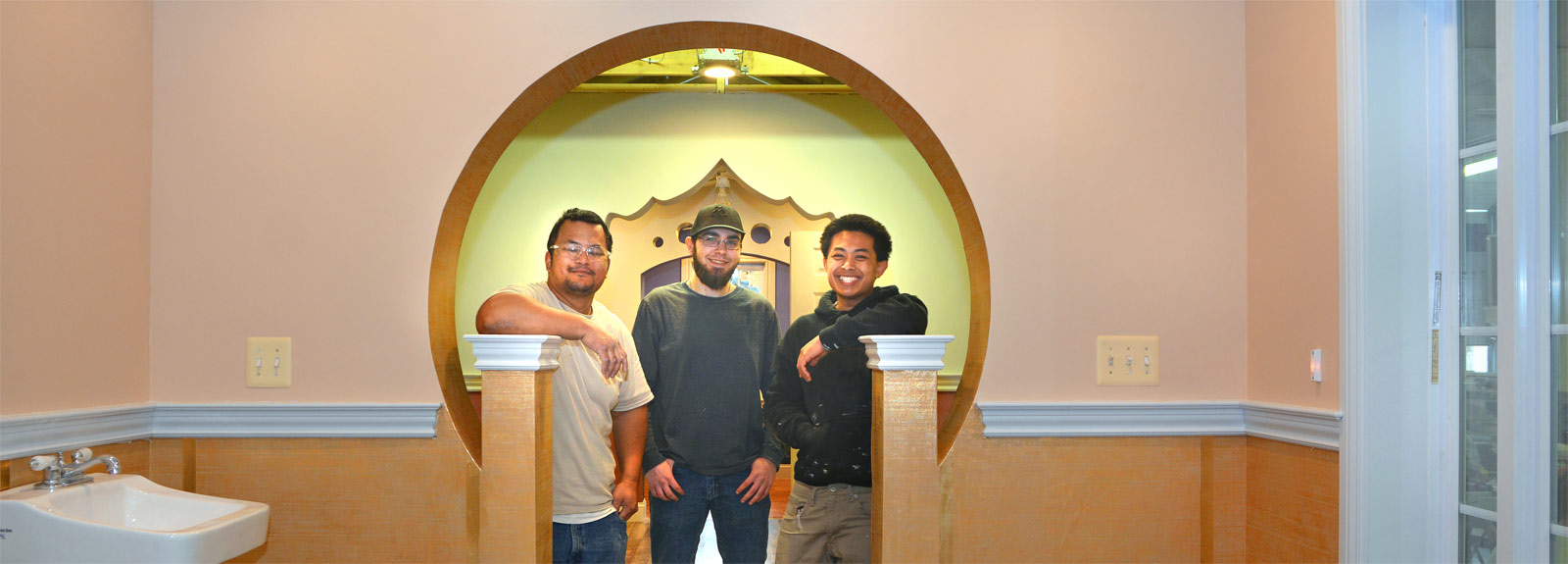 Three MTTI Building Trades Students Standing Under The Archway They Designed & Constructed.