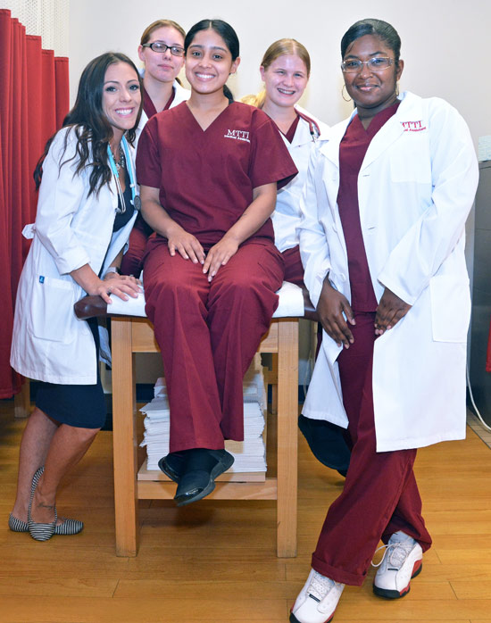 MTTI Instructor, Courtney Olson, WIth Medical Asistant Students.