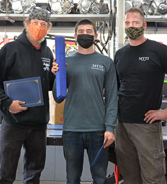Instructors With Evan Newman Who Has Torque Wrench He Earned