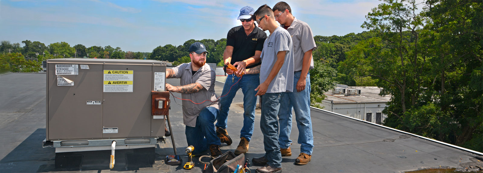 MTTI HVAC/R Technician students and Instructor perform preventive maintenance on roof-top air conditioning units.