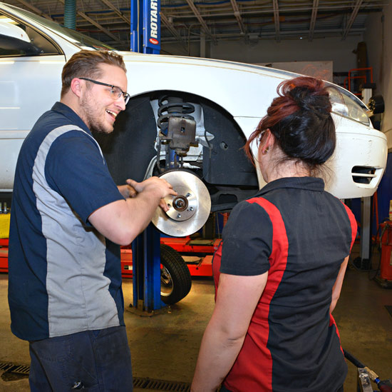 MTTI Auto Instructor, Jameson, explaining brake work  to female student.