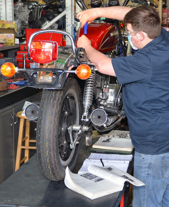 Kevin Breault, As A Student, Working On A Bike In MTTI's Shop.