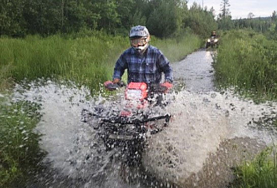 Kevin Breault, Driving His Bike Through Water In A Motocross Event.
