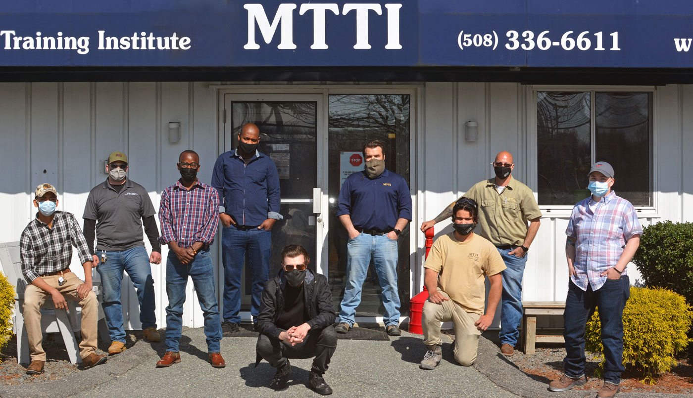 Luis With His Classmates In Front Of MTTI's Building At Leavitt Street.