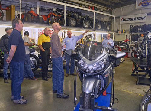 Motorcycle Program Advisory Committee Members visit the shop.