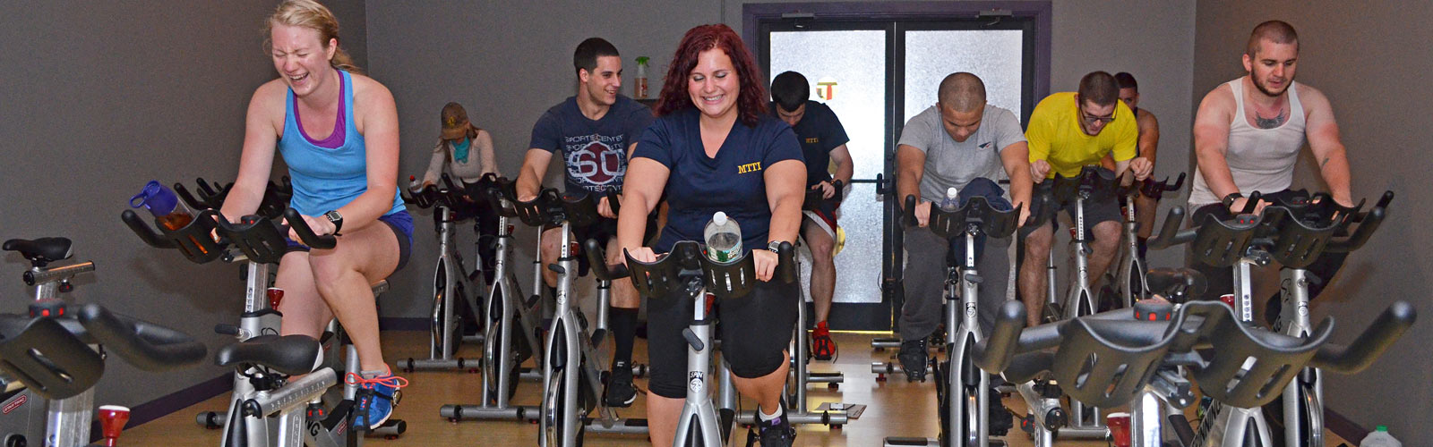 MTTI Personal Fitness Trainer students on stationery bikes during a Spin Class.