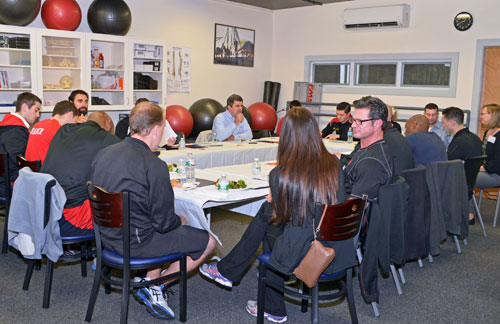 Members of MTTI's Personal Fitness Trainer Advisory Committee seated around a table.