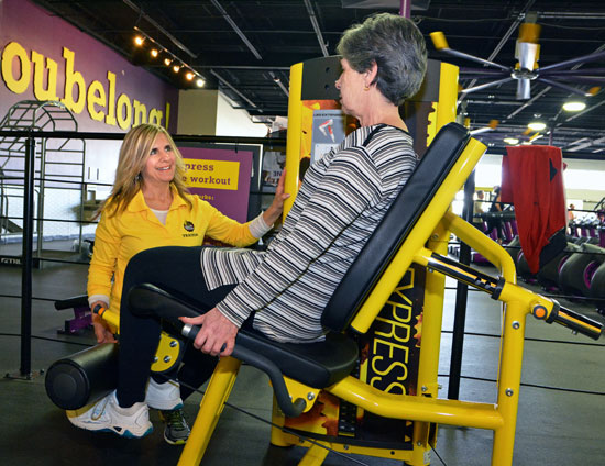 Pamela Padula training a client at Planet Fitness Coventry.
