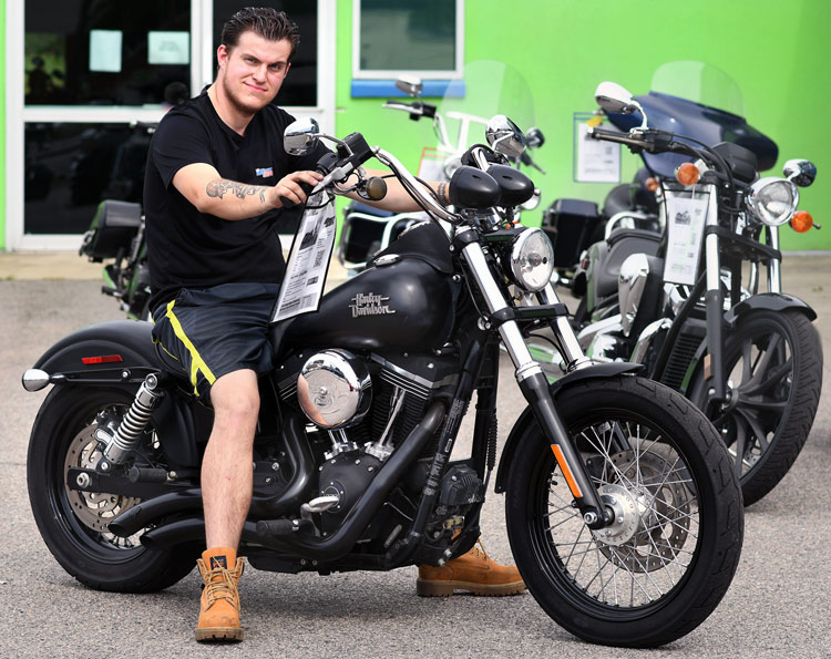 Robbie Thorp, Motorcycle Tech At Brockton Cycle Center, On A Harley-D Bike.