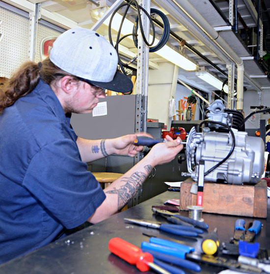 Robbie Thorp, Working On Equipment In MTTI's Motorcycle / Power Equipment Shop.
