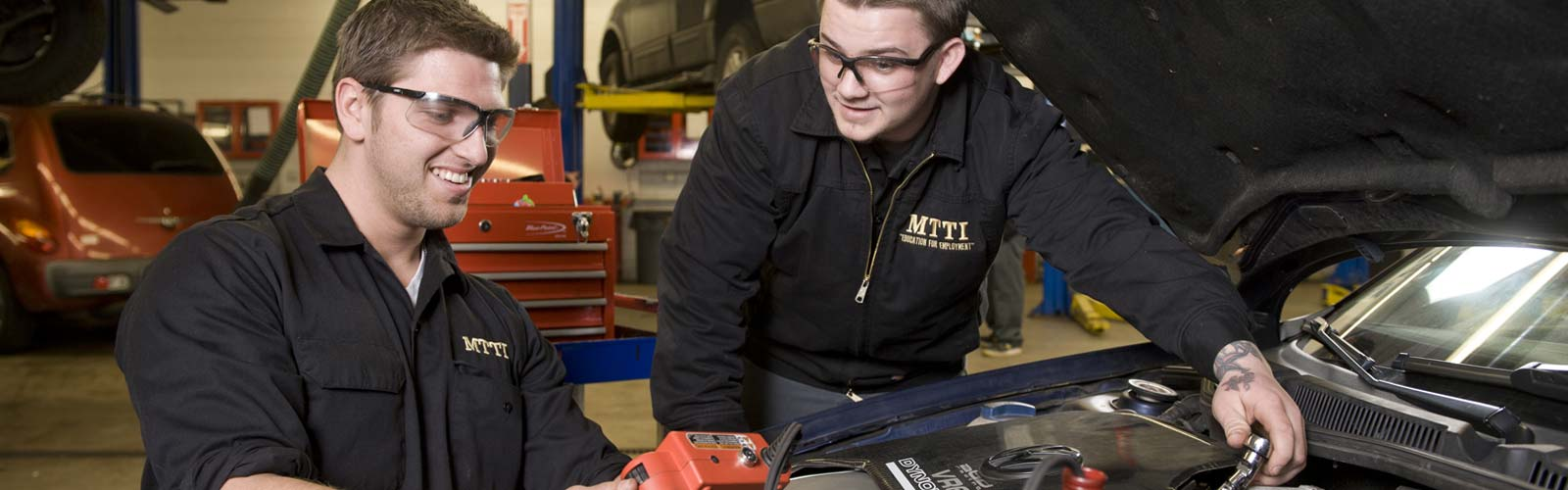 MTTI students working on a car