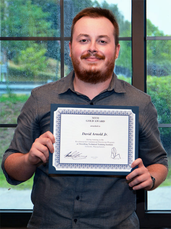 David Arnold Holding His Residential And Commercial Electrician Diploma.